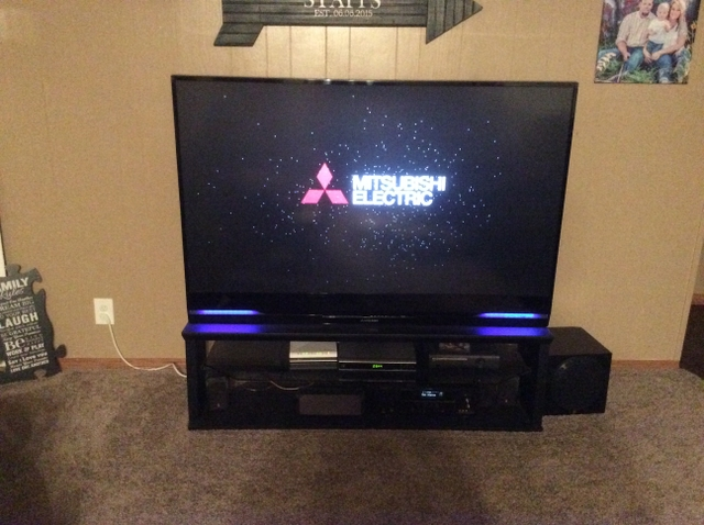 65 inch Mitsubishi TV and stand