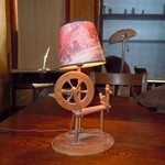 Old spinning wheel lamp.