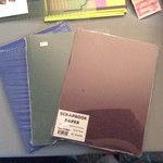 Three packs of scrapbook paper