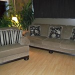 REDUCED - NEAR NEW ASHLEY COUCH & CHAIR