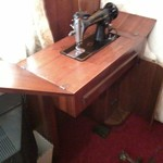 old singer sewing machine in cabinet,  $125.00