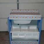 Baby changing table and bath in one on wheels