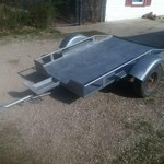 Motorcycle/mower trailer.