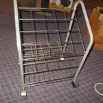Metal Magazine Rack on Wheels