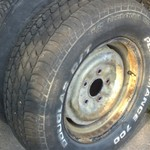 Old 14inch rims with good tires on them 5 on 4 1/2