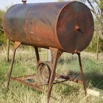 Oil tank and stand for furnace.
