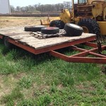 Tilt bed flatbed trailer
