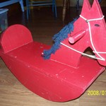 Antique looking red wooden rocking horse