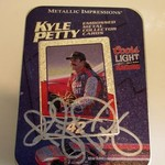 AUTOGRAPHED KYLE PETTY/COORS LIGHT TIN W/ 5 METAL CARDS