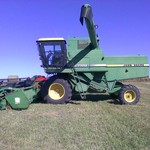 John Deere 7720 Combine with 224 Grain head