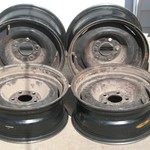 "SET OF FOUR 15"" FORD STEEL WHEELS"