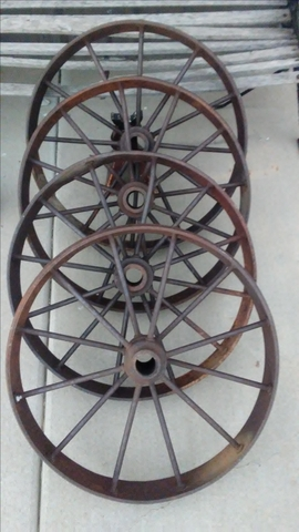 ANTIQUE STEEL WAGON AND IMPLEMENT WHEELS