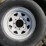 FOUR GOODYEAR UNISTEEL TIRES WITH RIMS
