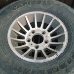4 used 31x10.5 r15 tires and Mopar rims