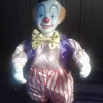 12 in. Porcelain Musical Clown