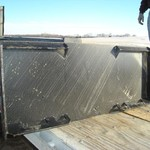 Skid steer attachment plates